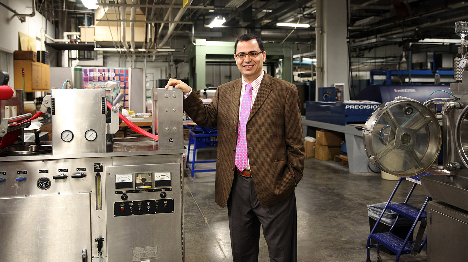 Dr. Ahmed El-Shafei stands near machinery in the dyeing and finishing lab in the College of Textiles. Dr. El-Shafei won a Walmart grant