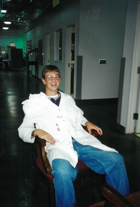 Philip Bradford as a teenager in STEP; sitting in a chair