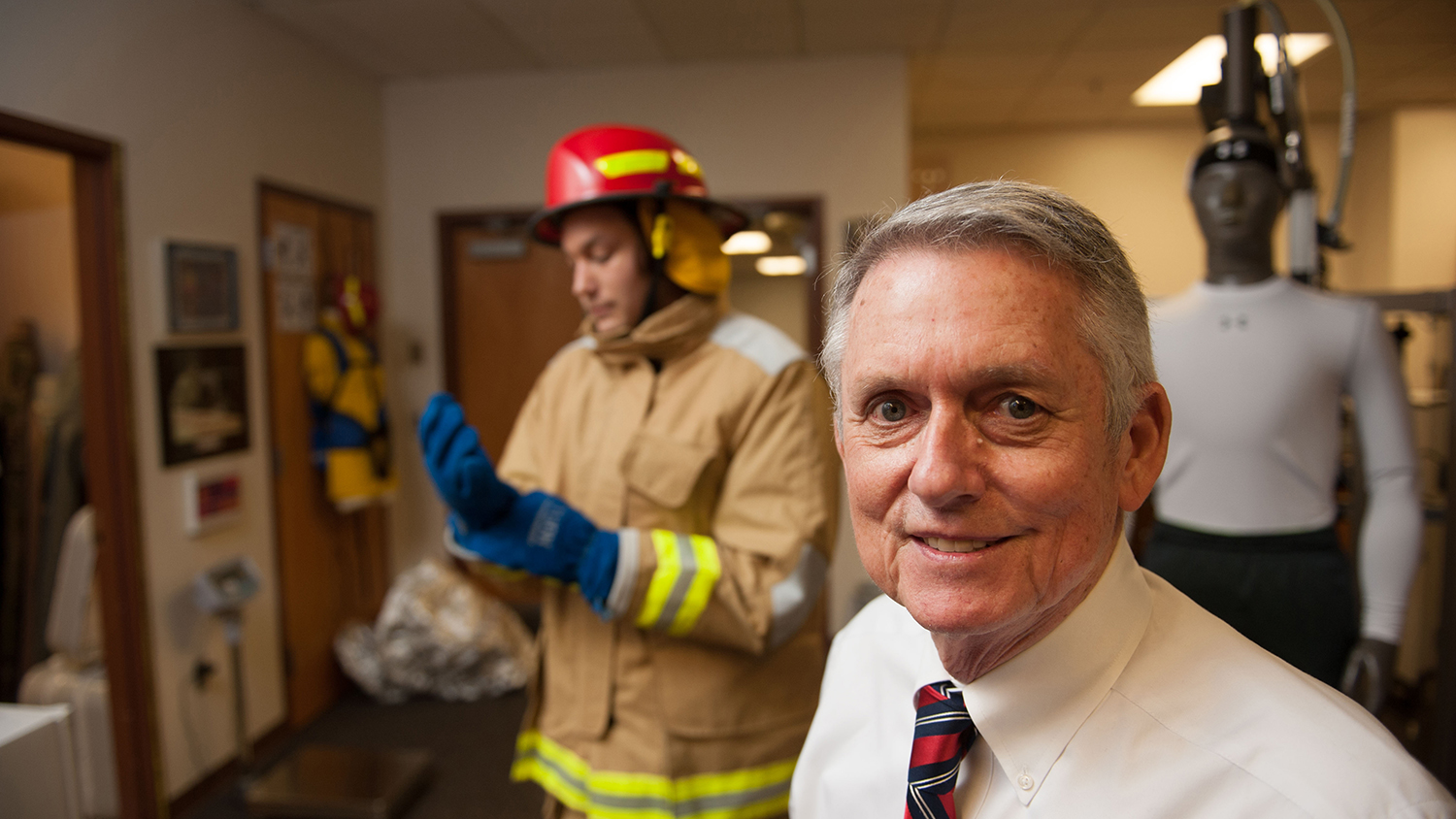 Roger Barker with a firefighter in the T-PACC lab