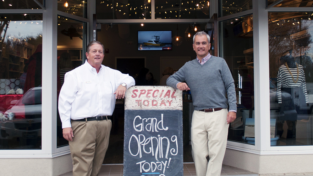 Ed Stack stands with Randy Ramsey, founder and president of Jarrett Bay Boatworks., outside of a soon-to-be opened retail store.