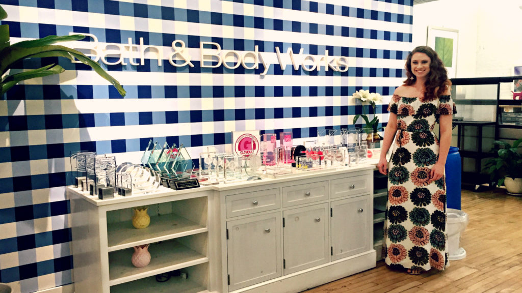 NC State Wilson College of Textiles Hayley Klumpe stands in front of Bath and Body Works sign
