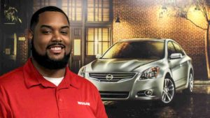 NC State COT alumnus Adam Barksdale in front of Nissan car