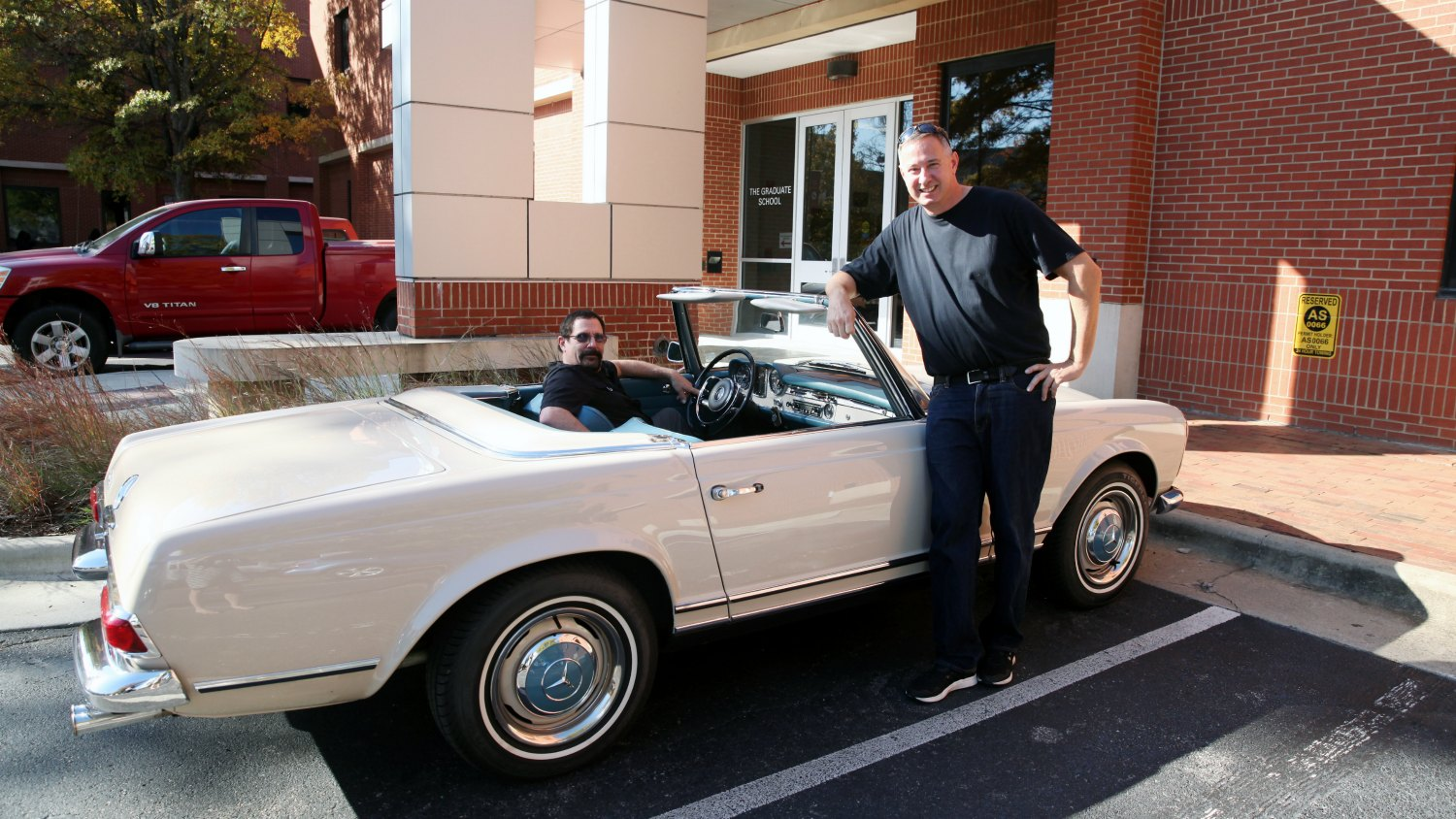 Alex Djuric stands in front of his beige 1967 250 SL Mercedes, while Jeffrey Krauss sits in driver's seat