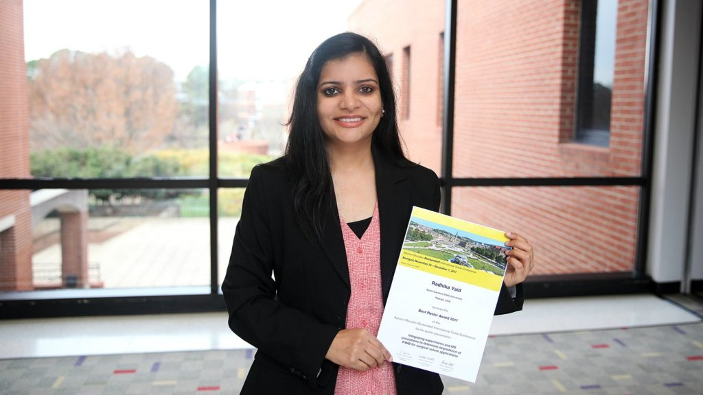 Wilson College of Textiles Fiber and Polymer Science Ph.D. student Radhika Vaid poses with her winning poster