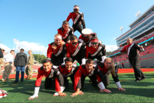 NC State marching band members form a pyramid