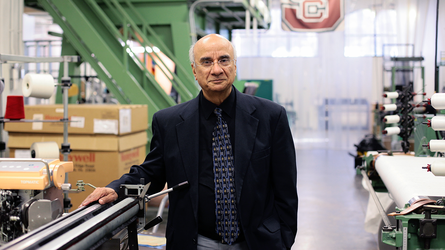 Dr. Abdul-Fattah Mohamed Seyam stands in front of machinery in the College of Textiles weaving lab