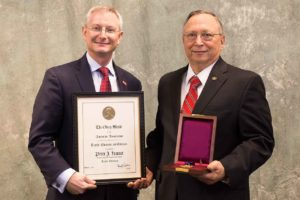 Dr. David Hinks, dean of the College of Textiles stands with Olney Medal recipient Dr. Peter Hauser