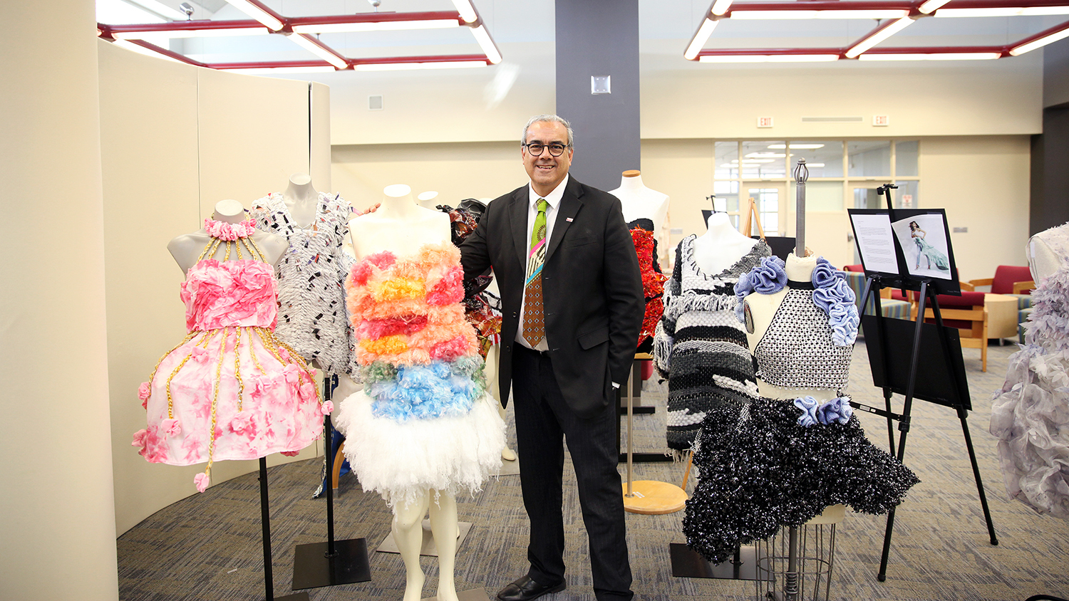 Leader of the Year Andre West stands with student work in the iLab at the College of Textiles