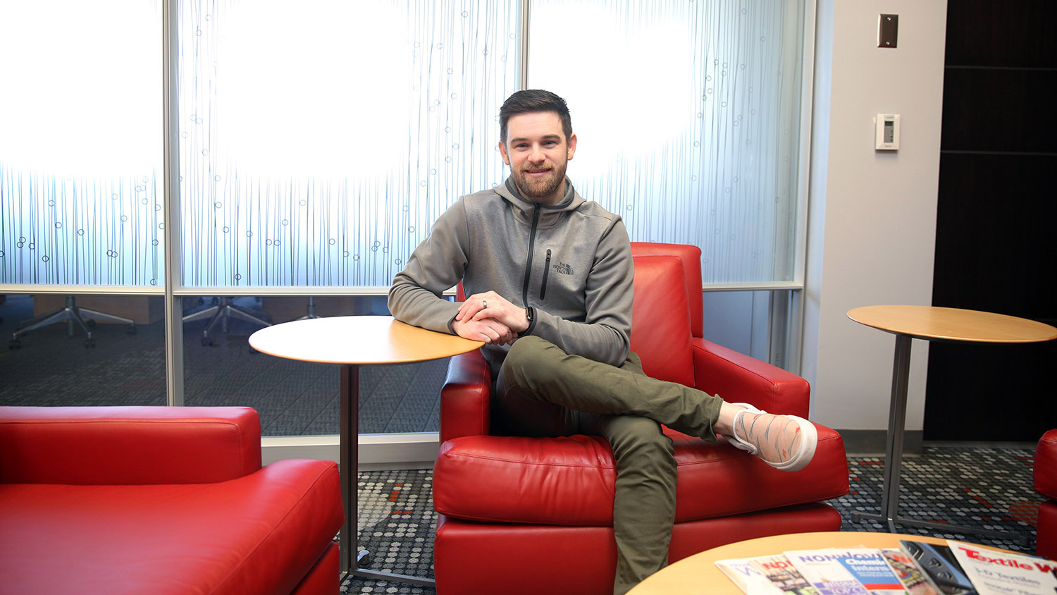 Colin Holloway leads footwear innovation at VF. He sist in the lounge in the College of Textiles