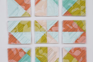 Deconstructed quilt in shades of green, pink and blue by Kelsey Boes