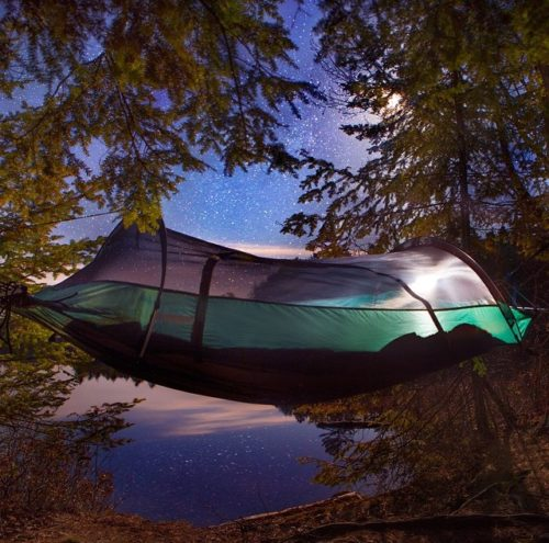 Blue Ridge Camping Hammock suspended between two trees under a full moon