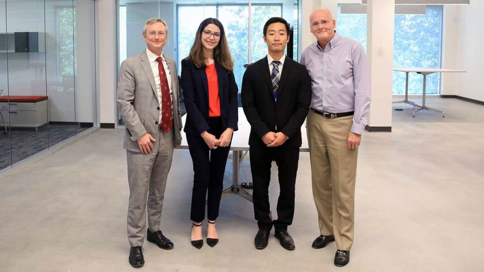 College of Textiles dean, Dr. David Hinks, and VF Corporation vice president Scott Deitz stand with VF assistantship recipients Zahra Saki and Inwhan Kim