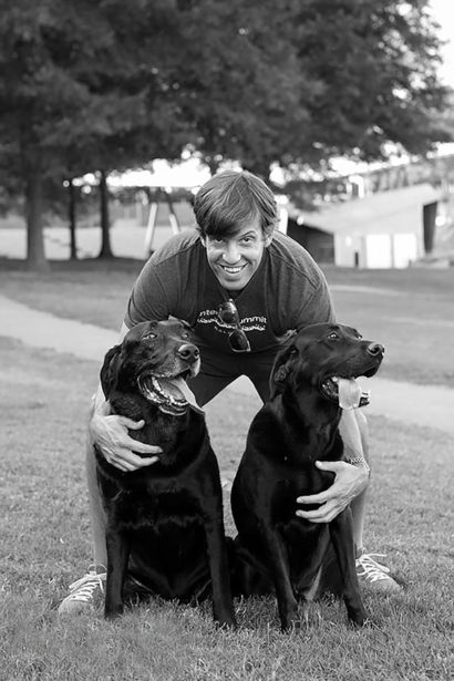 Lawson Hammock founder Wes Johnson hugs his two black labs