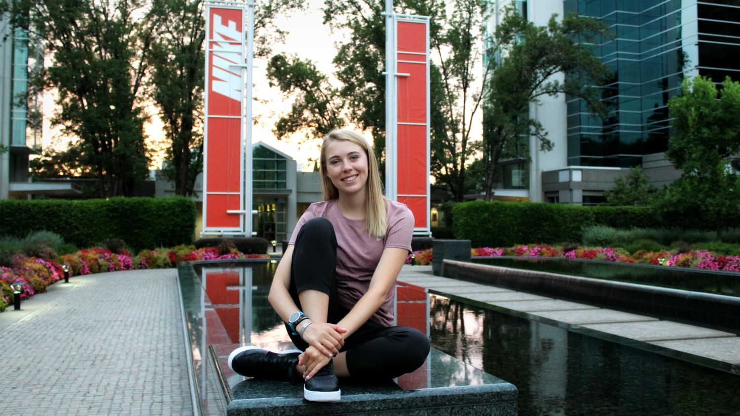 NC State College of Textiles TE major Carmen Davis sits in front of Nike signs
