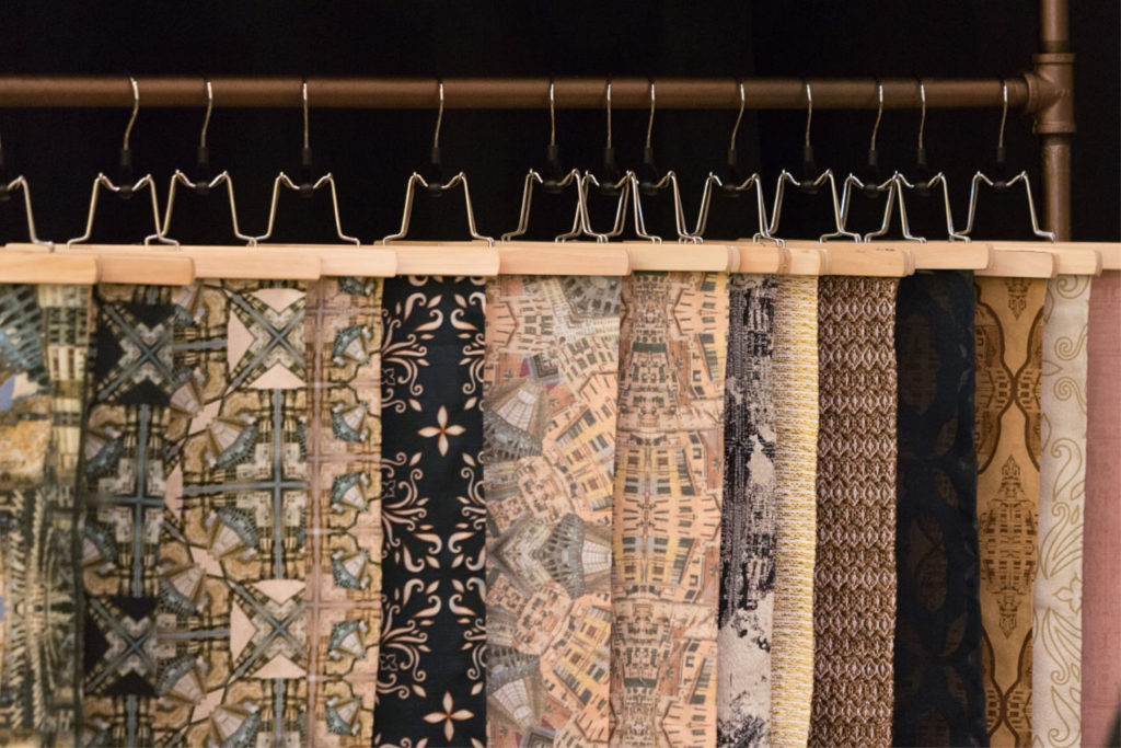 Various textile patterns hung for display