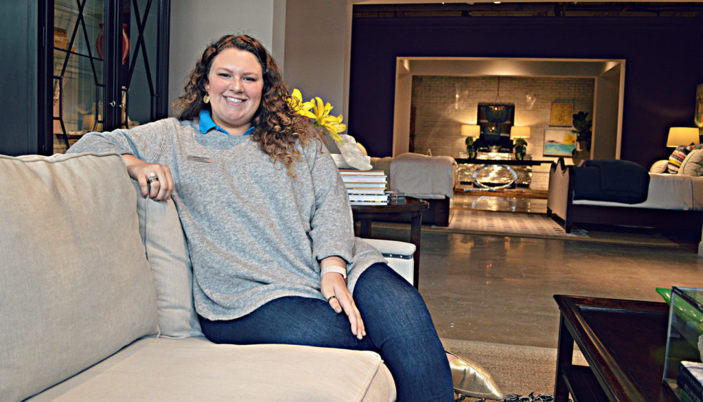 Jessica Worley seated on couch in Universal showspace at High Point Market