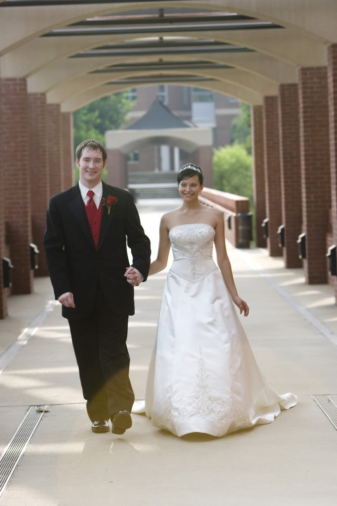 Drs. Bryan and Sasha Ormond at their wedding on the campus of NC State Wilson College of Textiles