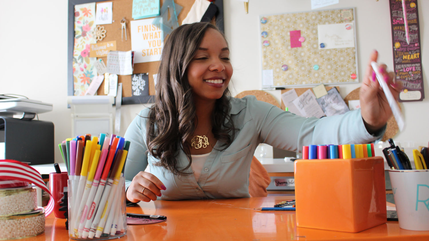 Wilson College of Textiles alumna Jasmine Flood at desk with colorful markers