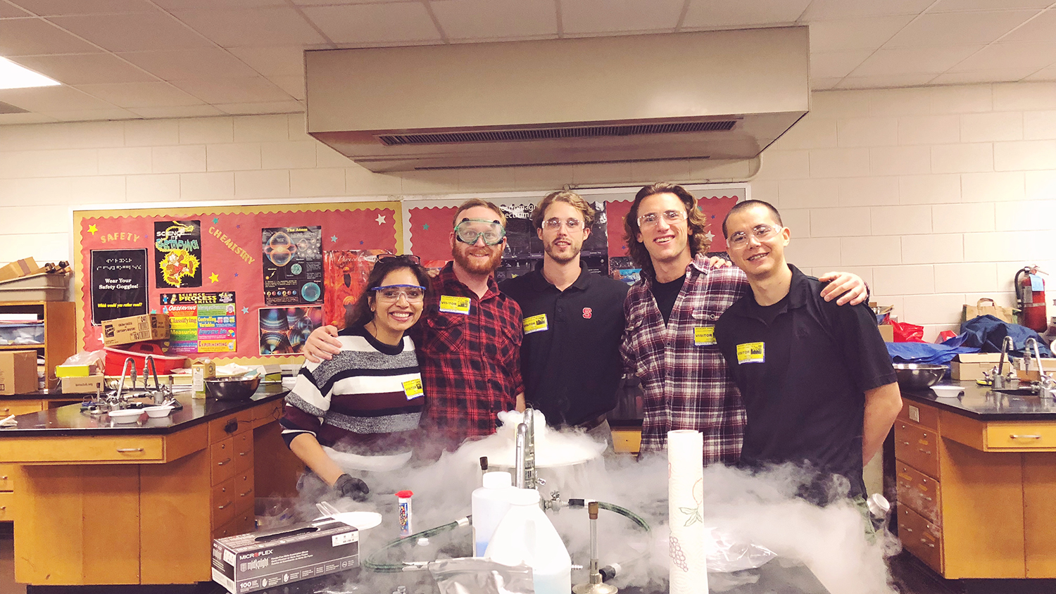 The group of Materials Research Society students who conducted STEM outreach pose at Hickory High School in a science lab.