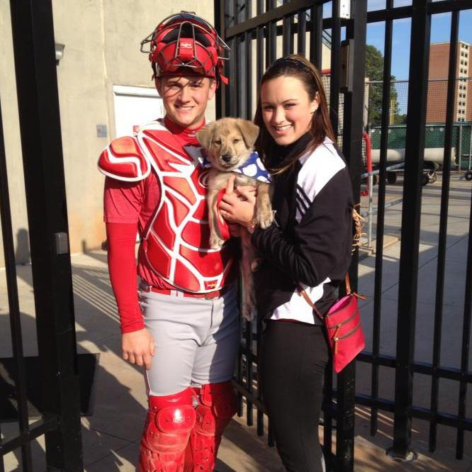 Shane and Tamryn O'Toole pose with their puppy.