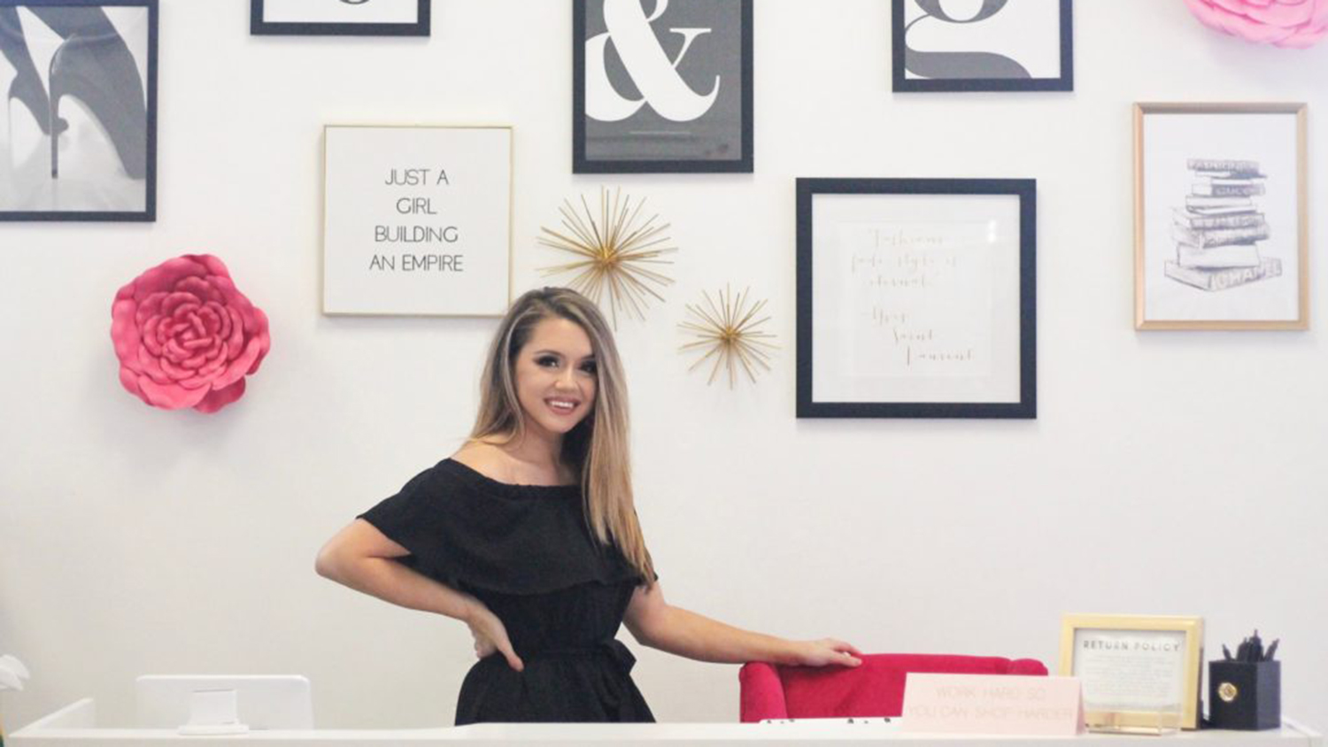 Emily Harris in front of Jack & Georgia gallery wall
