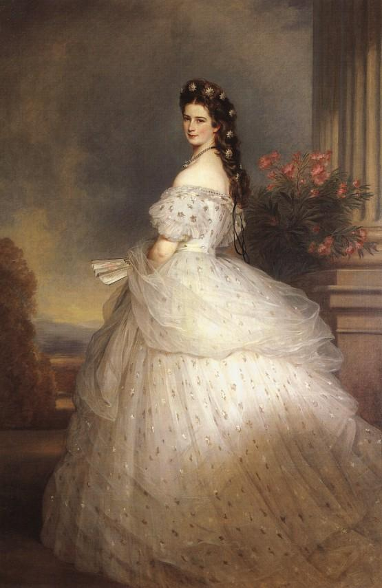 Portrait of Empress Elisabeth of Austria dressed in a pale dress with voluminous skirts. She looks at the viewer over her left shoulder.