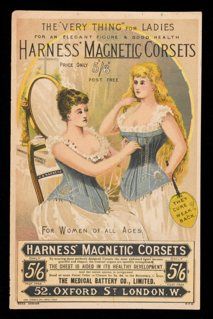 1892 ad for Harness' Magnetic Corsets which shows two women, one seated and one standing, wearing the corsets.