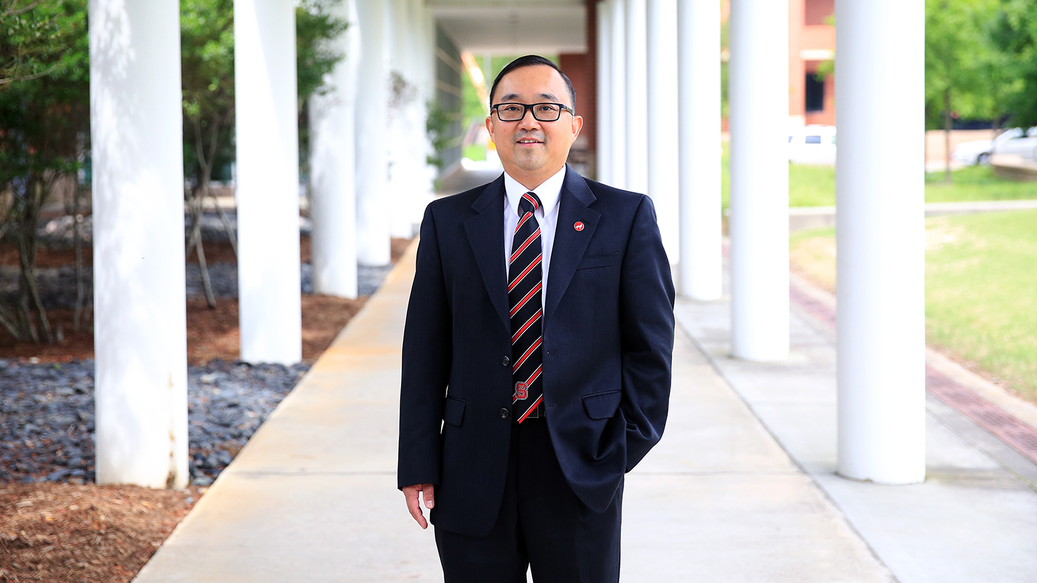 Dr. Xiangwu Zhang stands under walkway on Centennial Campus at NC State