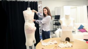 Photo of FTM grad Sophie Nunno-Gorbachev displaying some of the bras she has used in her undergraduate research