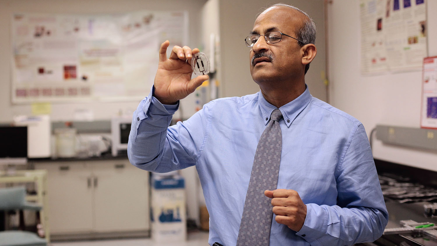 Dr. Tushar Ghosh inspects a fiber-based sensor