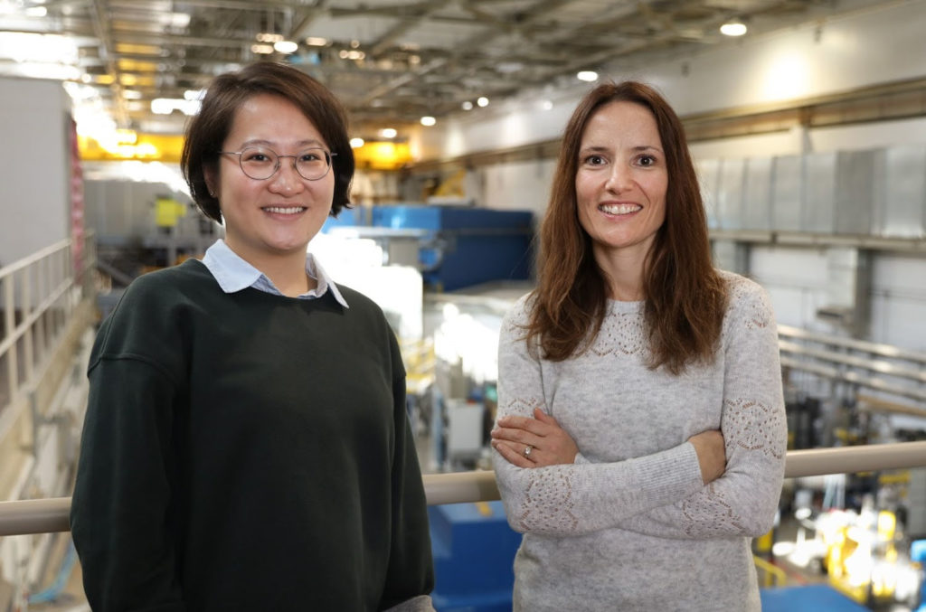 Yue Yuan and Flora Meilleur face the camera within Oak Ridge National Laboratory