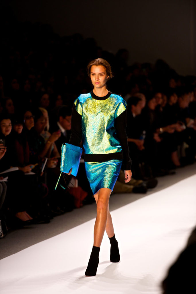 Model Josephine Skriver on the Milly runway at NYFW, wearing a sequined blue/green/chartreuse dress