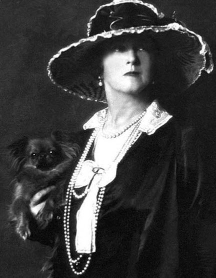 Black and white portrait of Lady Duff Gordon in a wide-brimmed hat and suit with pearls
