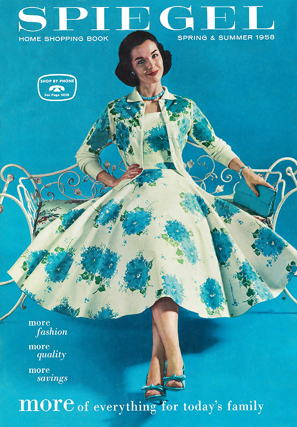 1958 Speigel catalog featuring woman with a brunette bob wearing an ivory dress with full skirt and matching jacket with print of blue hydrangeas. The model is against a turquoise blue backdrop