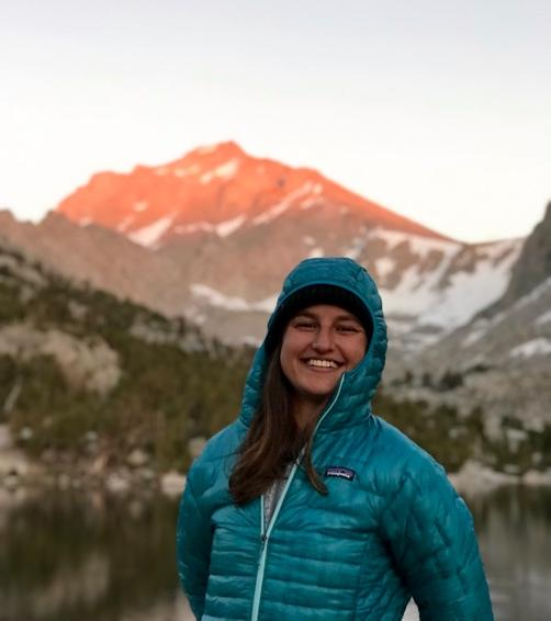 Julia Koehler in mountains wearing a turquoise Patagonia jacket