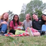 Anne Graf and group in park, sitting on a blanket