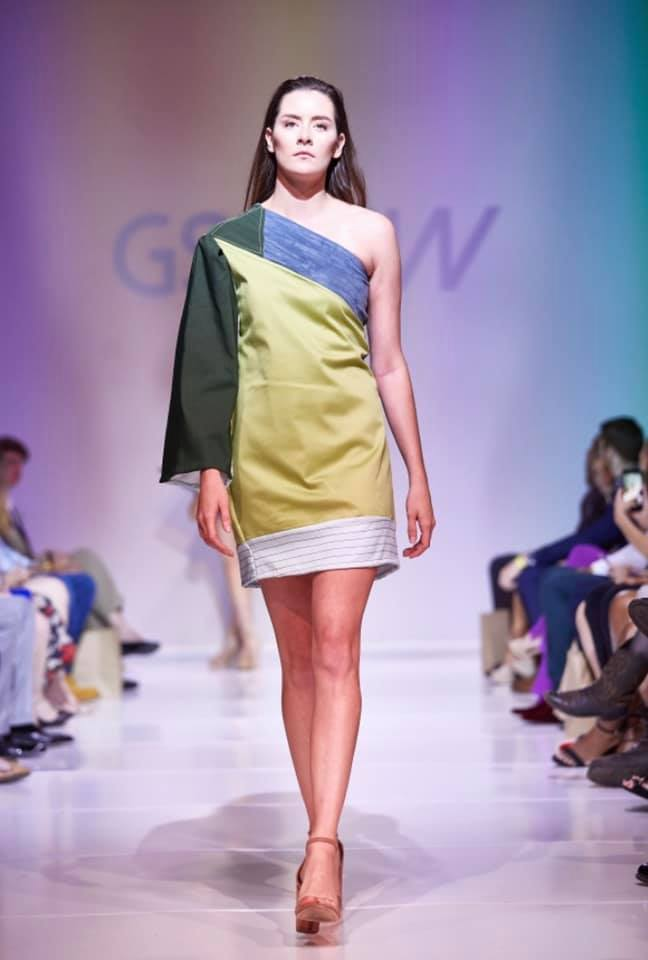 Model wearing color blocked dress designed by Alexandra Plunkett