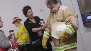 Open House attendees try on protective gear.