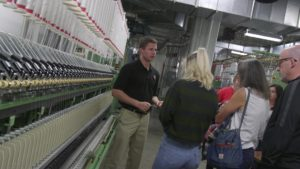 Open House attendees examine textile machinery.