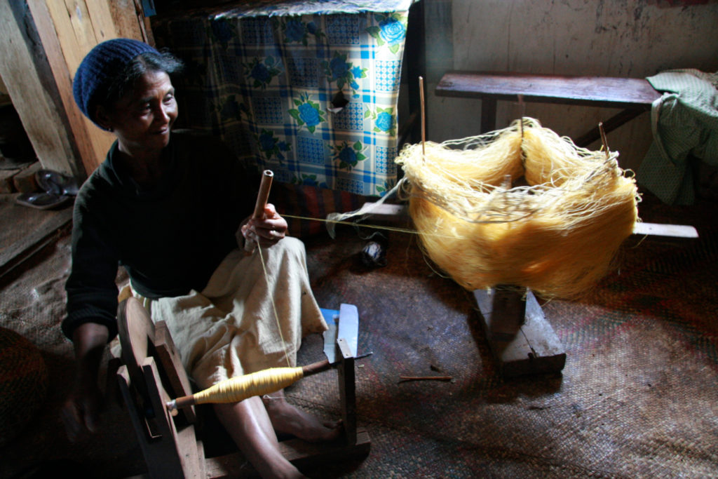 A woman named Marie spinning wild silk