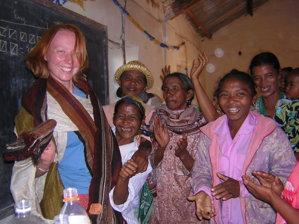 Kyley Schmidt celebrates with Malagasy weavers