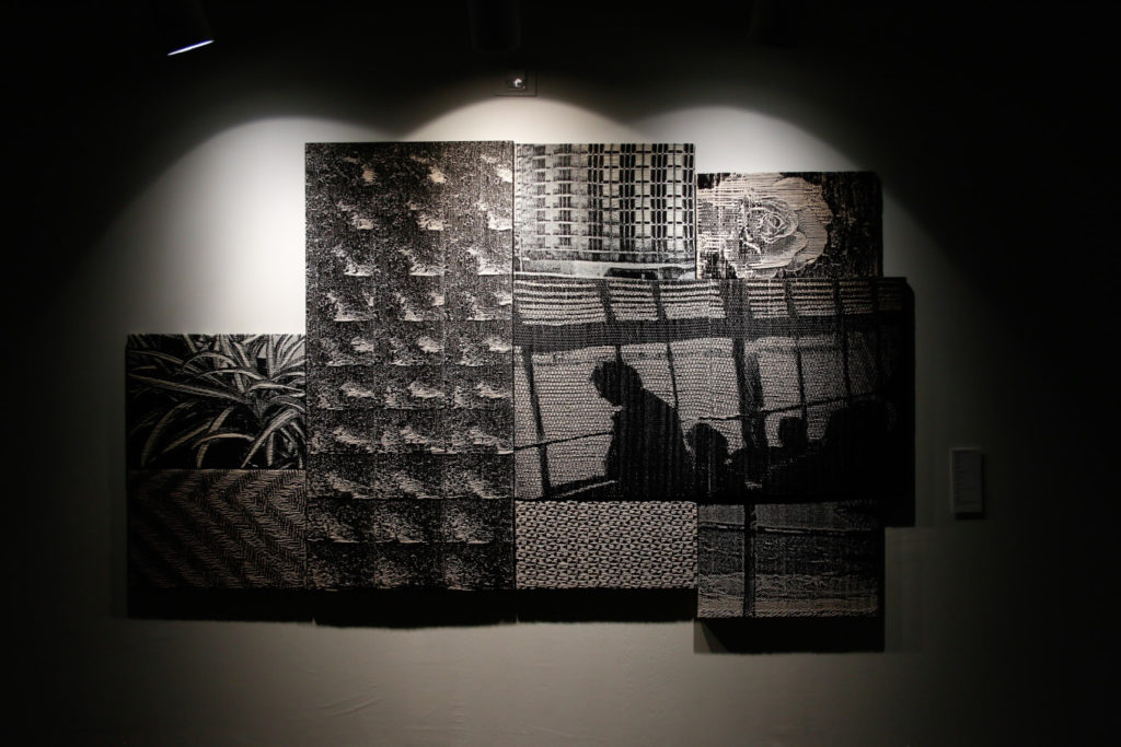 """Photo of a grouping of Jacquard weavings that look like stills from a black and white movie. Installation by Kate Nartker in the show """"If You Have Ghosts."""""""