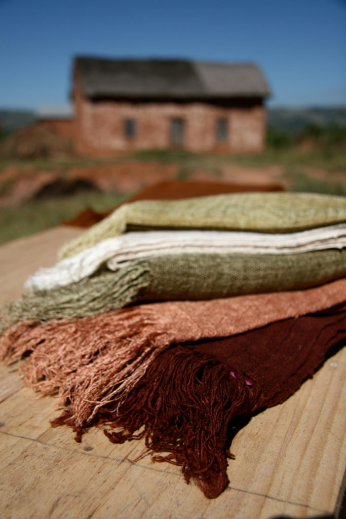 Deep burgundy, rose, moss green and ivory colored lambas woven from Borocera silk