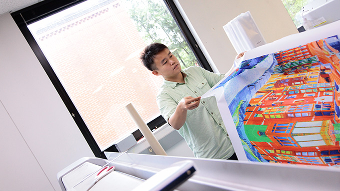 Student observing a printed piece of fabric