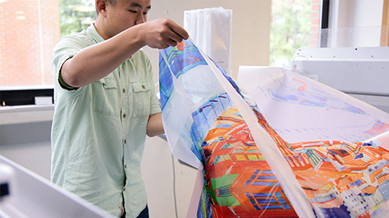 Student working with digital fabric printer