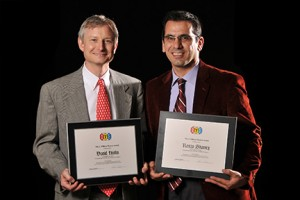 David Hinks and Renzo Shamey hold awards from the AATCC