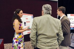 A student presents her research to Dr. Bradford and Dr. Oxenham