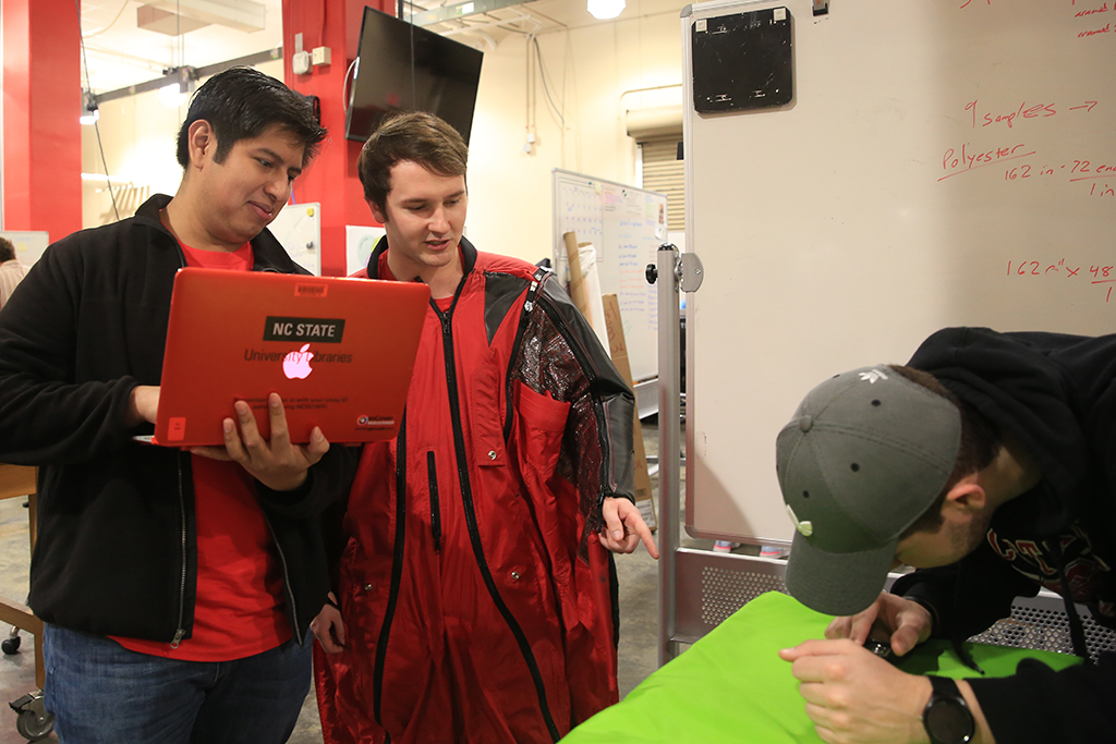A photo of the Wingsuit team working on their project