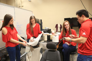 A photo of the Natural Fiber Wovens for Automotives team working on their project