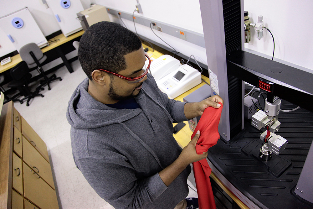 Student observing a red fabric